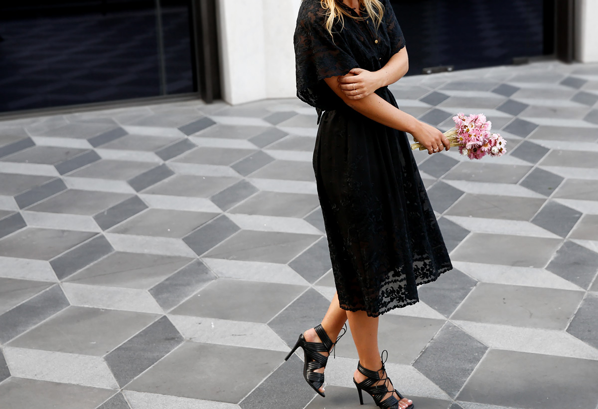 wearing Zimmermann lace dress with Senso heels at Eastland's grand opening