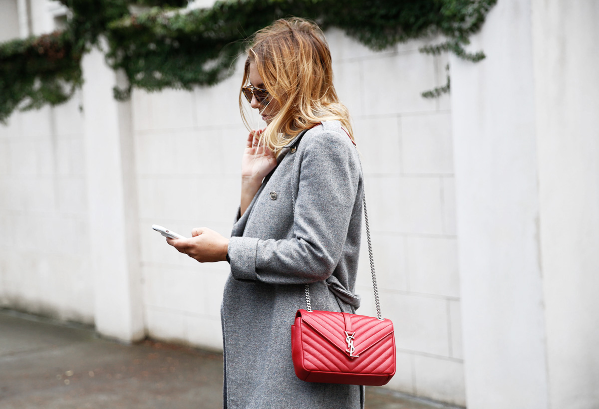 blogger on street on phone with ysl red bag
