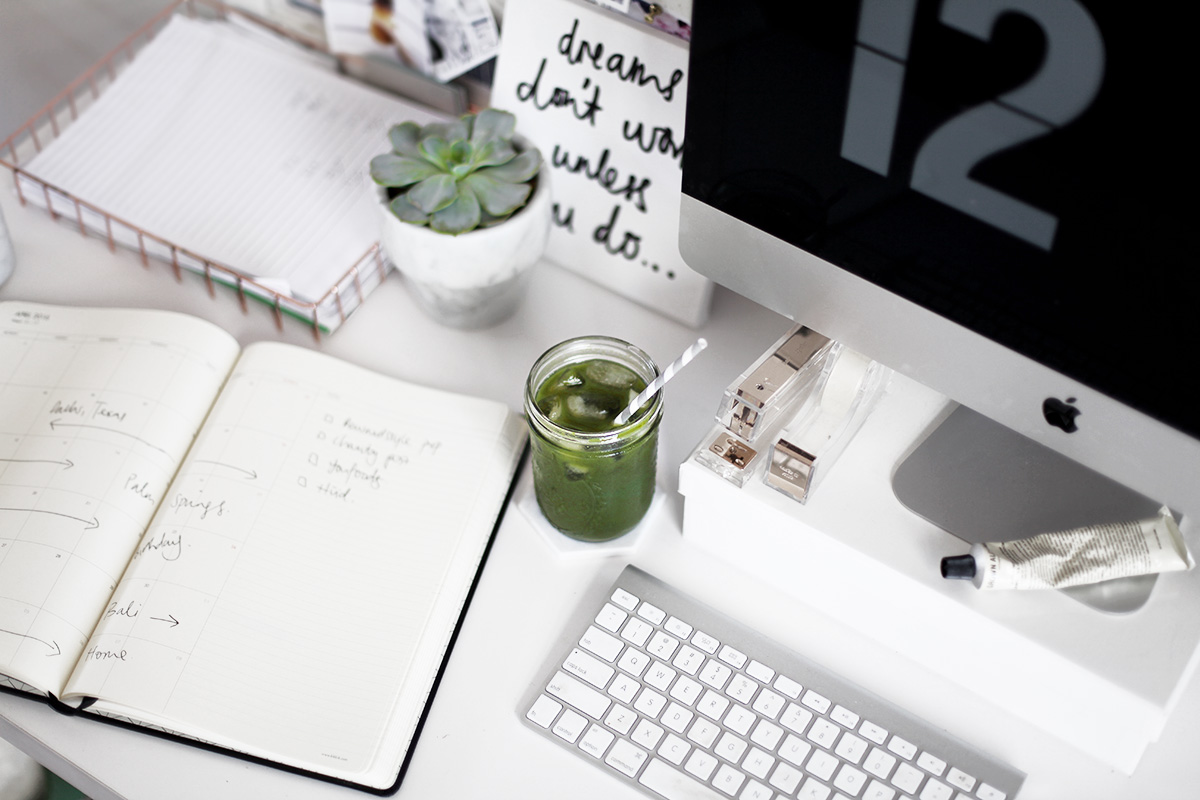 studying in the home office with a green juice