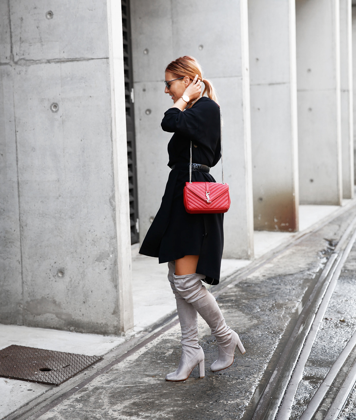 walking to fashion week in over the knee boots