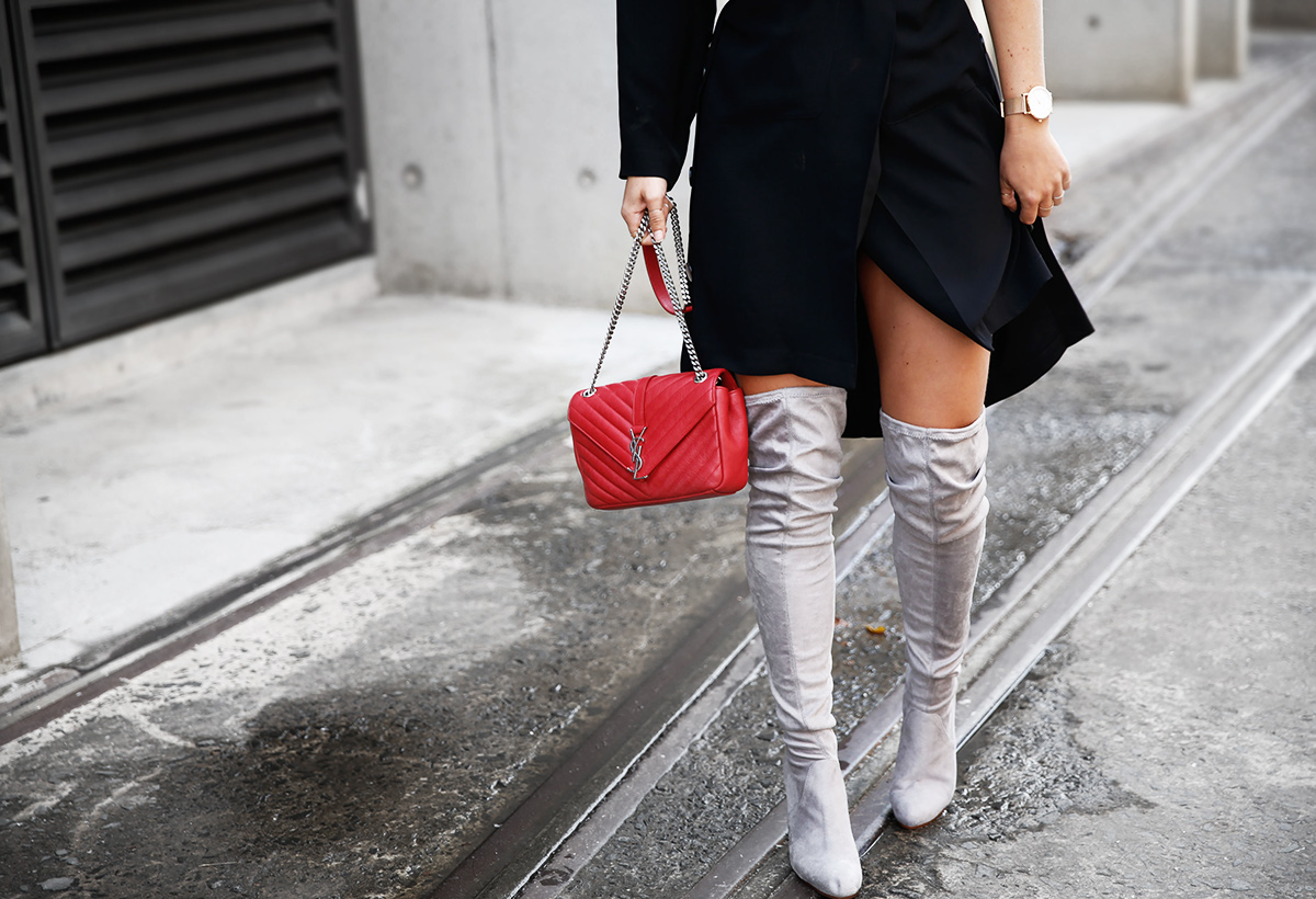 leaving fashion week in thigh high boots and red saint laurent bag