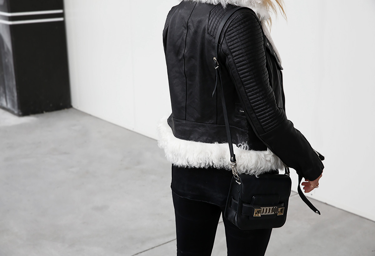 wearing a shearling leather jacket