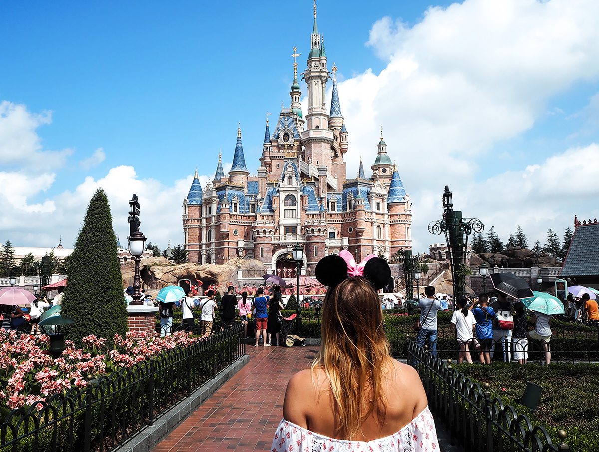 blogger Lisa Hamilton attending Shanghai's Disneyland Resort in an off the shoulder dress