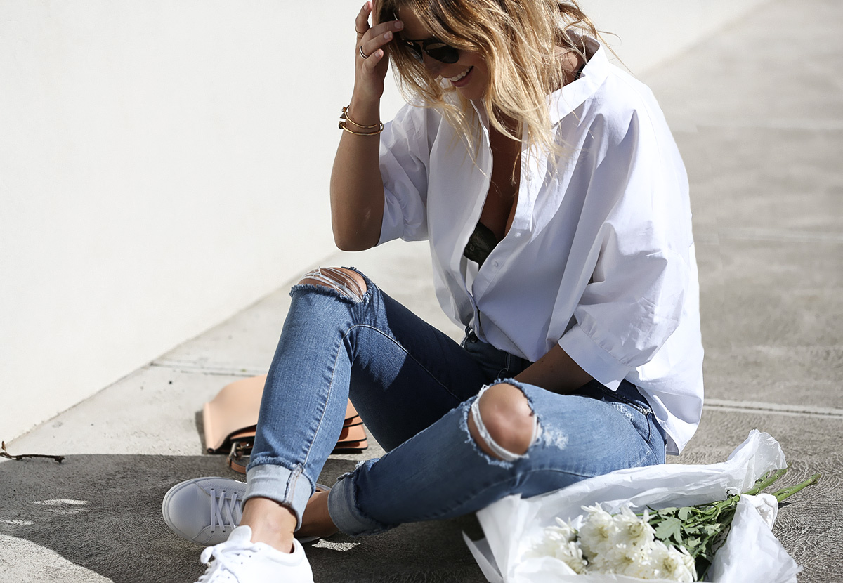 Blogger Lisa Hamilton from See Want Shop styling a lace bodysuit with Cos white shirt & ripped jeans