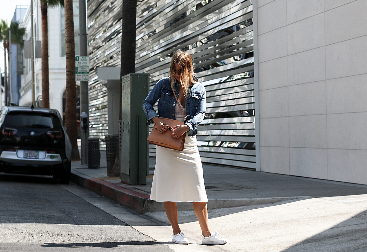 Fashion blogger Lisa Hamilton from See Want Shop styling a lace bodysuit on Rodeo Drive, Beverly Hills