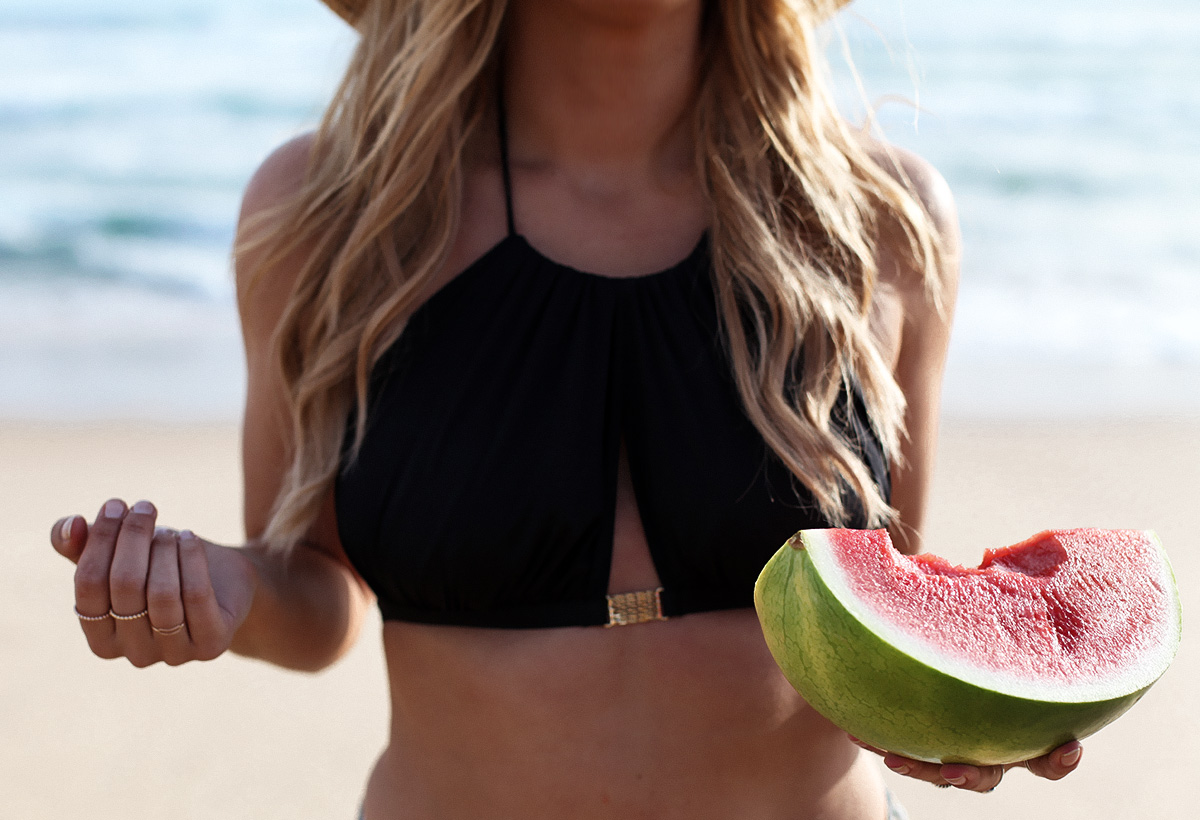 Fashion & travel blogger Lisa Hamilton from See Want Shop wearing a L'Agent by Agent Provocateur bikini with a watermelon at the beach