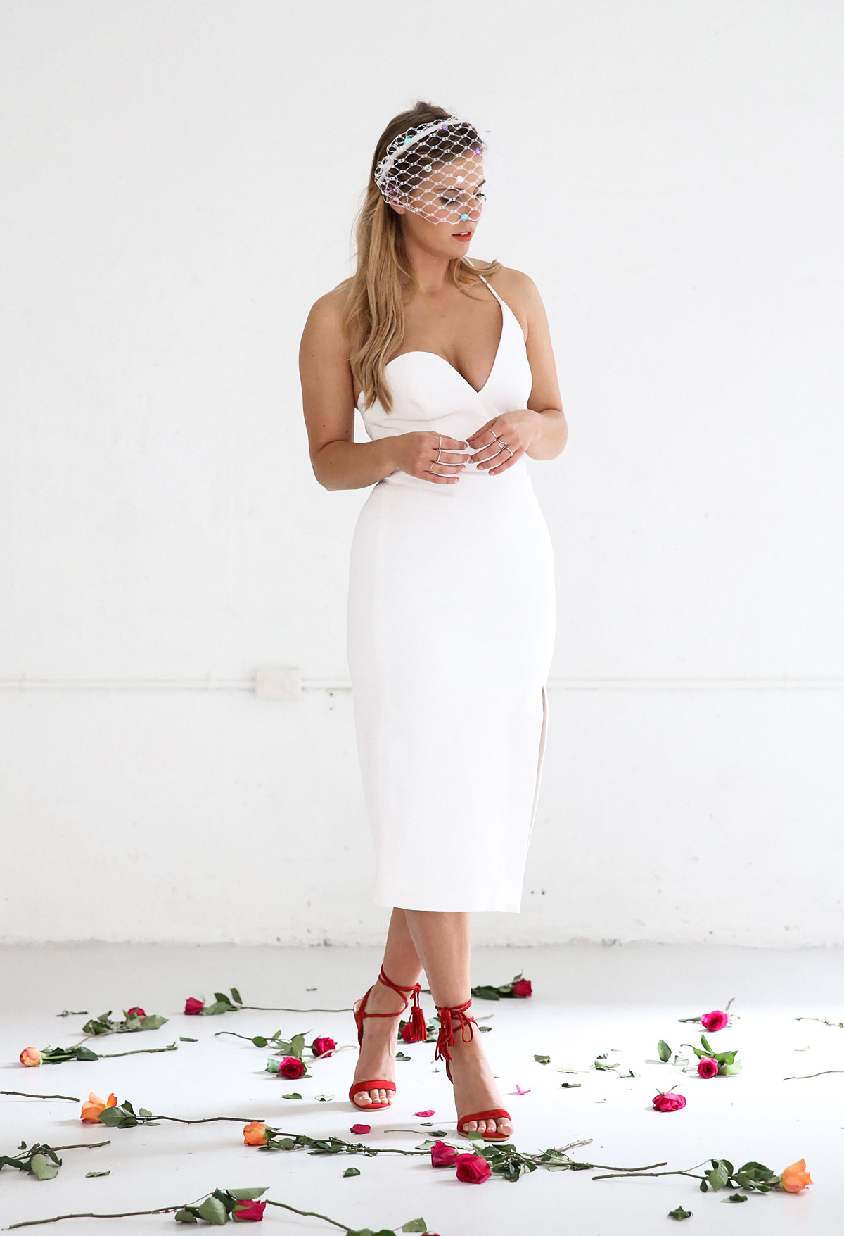 Australian fashion blogger Lisa Hamilton styling a white C/meo Collective dress & veil for spring racing