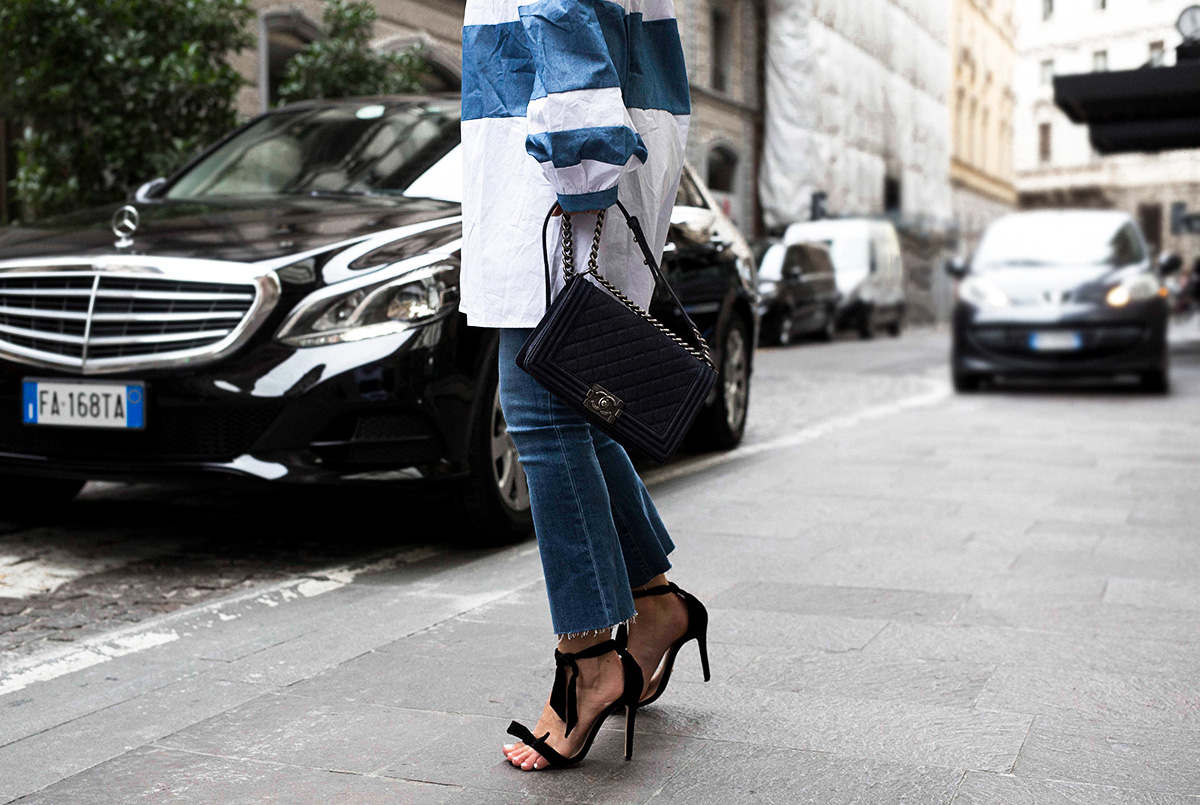 Style blogger Lisa Hamilton wearing Paige Denim jeans with Chanel bag at Milan Fashion Week with Etihad Airways