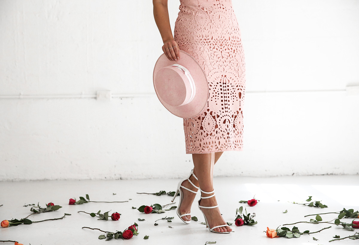 Fashion blogger Lisa Hamilton styling a pastel lace dress for Oaks Day at the spring racing carnival