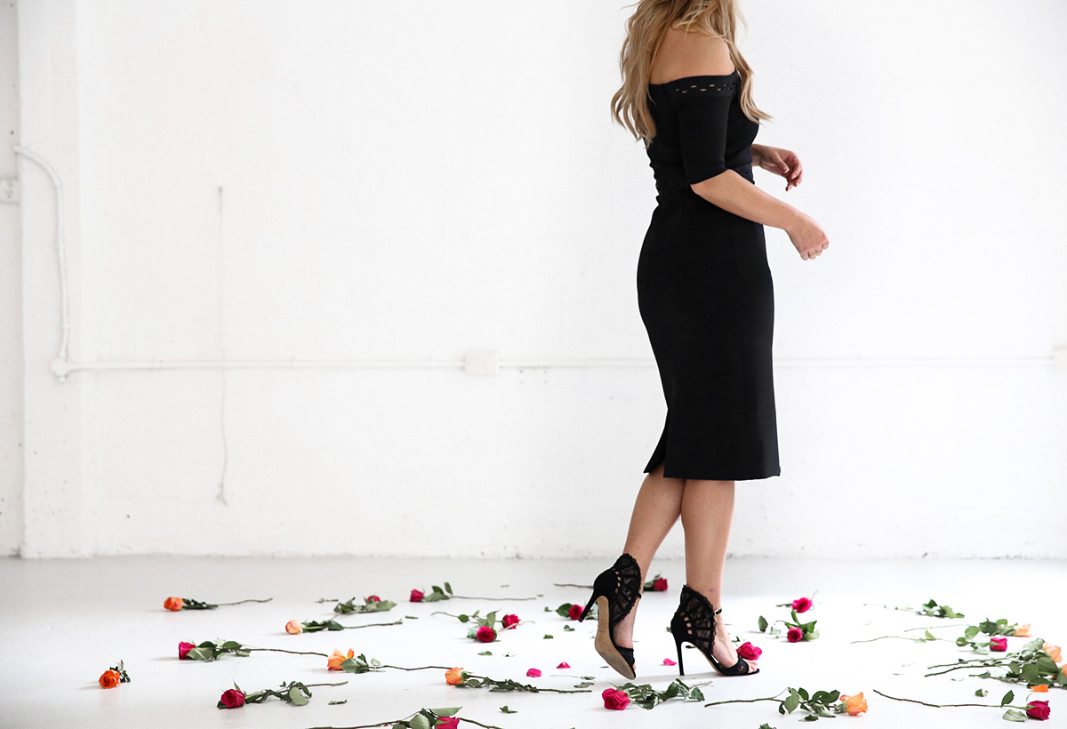 Fashion blogger Lisa Hamilton styling a black Dion Lee dress for Derby Day