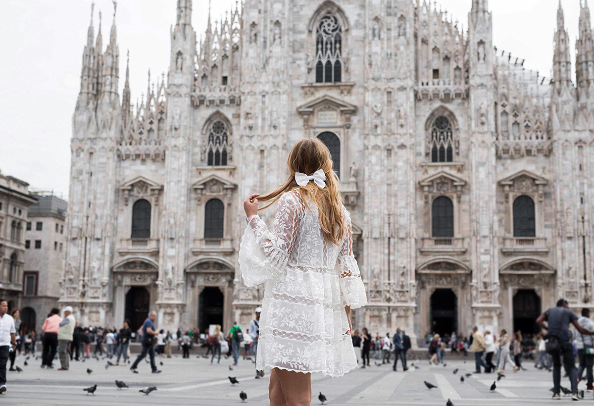 Travel blogger Lisa Hamilton styling a lace Thurley dress at Milan Fashion Week