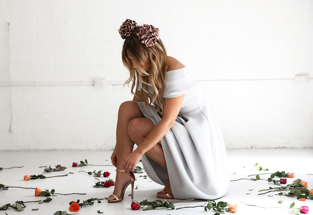 Australian fashion blogger Lisa Hamilton styling an off the shoulder dress with flower crown ears for Oaks Day at the spring racing carnival