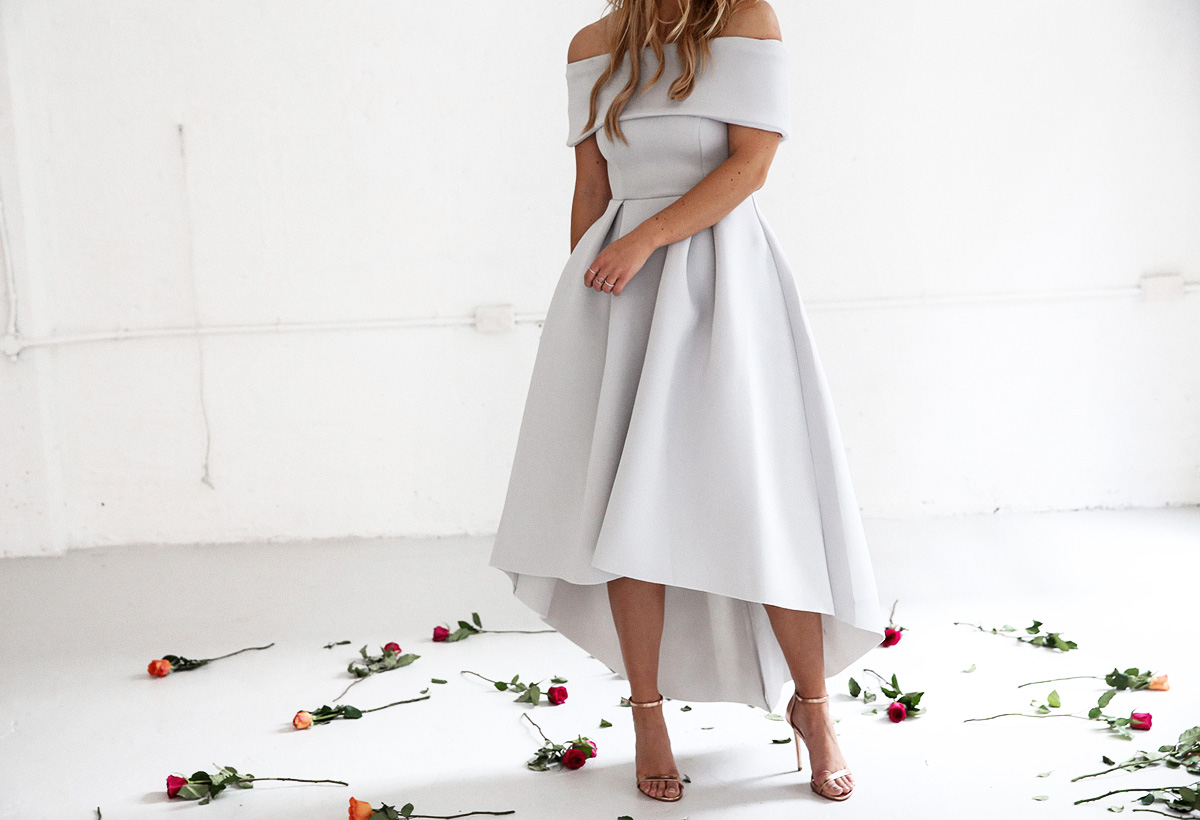 Fashion blogger Lisa Hamilton styling an off the shoulder dress for Oaks Day at the spring racing carnival