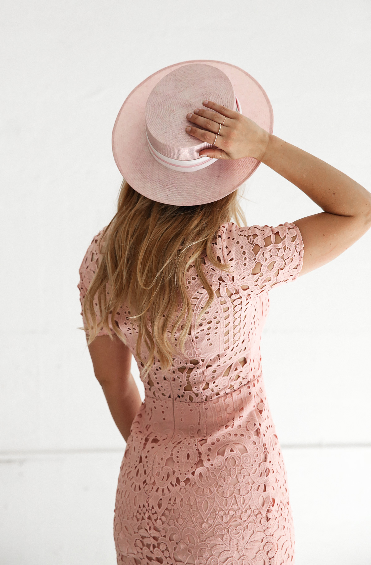 Fashion blogger Lisa Hamilton styling a pastel lace dress  & straw boater hat for Oaks Day at the spring racing carnival