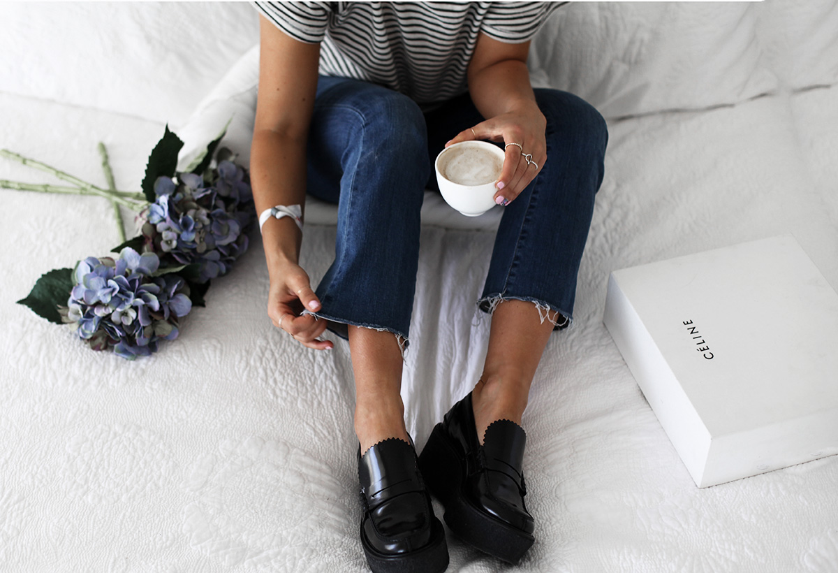 Style blogger Lisa Hamilton wears Celine black platform loafers & Paige Denim jeans from Yoox online store