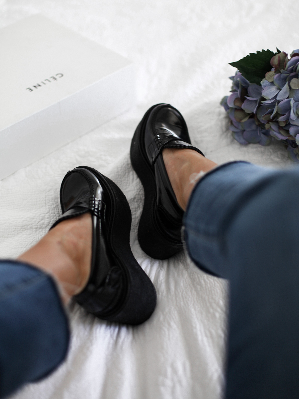 Style blogger Lisa Hamilton wears Celine black platform loafers & Paige Denim crop jeans from Yoox online store