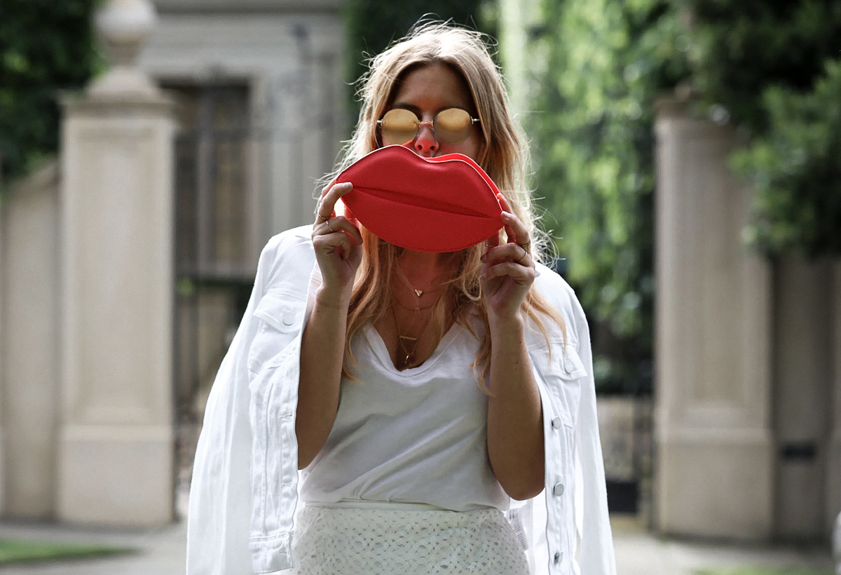Fashion blogger Lisa Hamilton from See Want Shop styling a red lippy clutch this Christmas