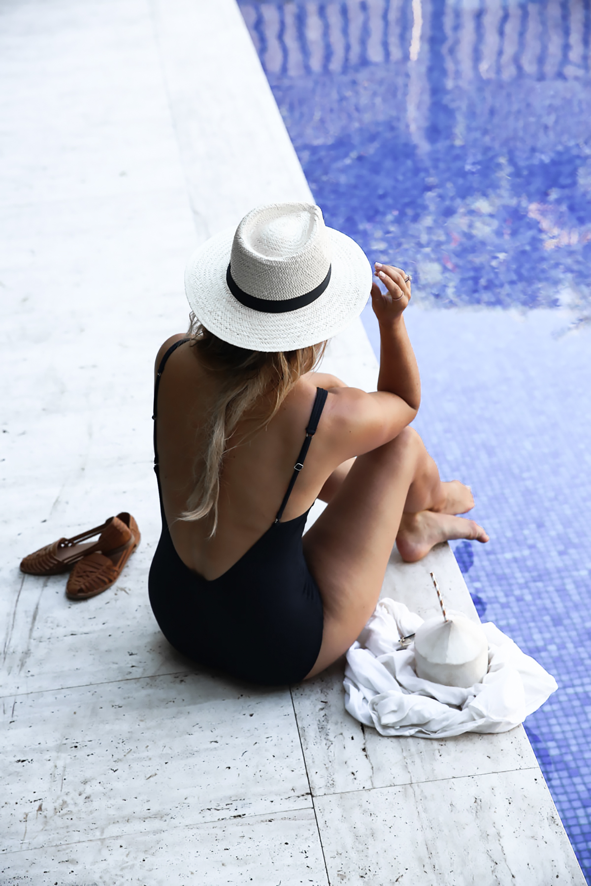 Lifestyle blogger Lisa Hamilton from See Want Shop wearing backless lace up swimsuit from Marks & Spencer & straw panama hat during summer
