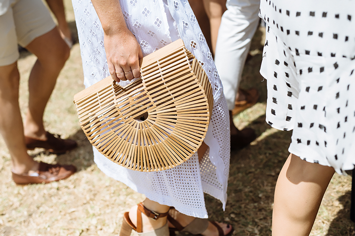 Polo goer with a structured wooden bag at the Portsea Polo