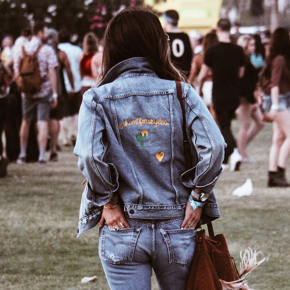 Style blogger Lisa Hamilton from See Want Shop compiling the best Coachella outfits with embroidered denim