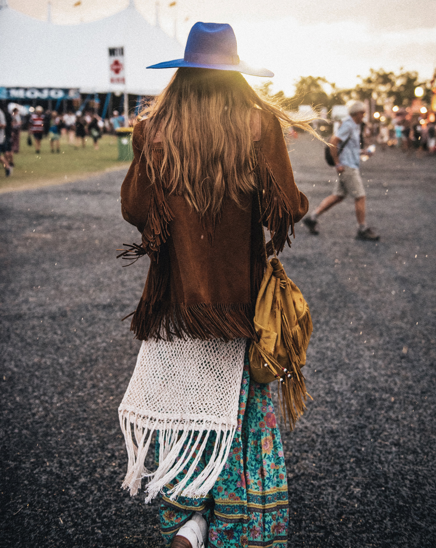 Style blogger Lisa Hamilton from See Want Shop compiling the best Coachella outfits with a fringe jacket
