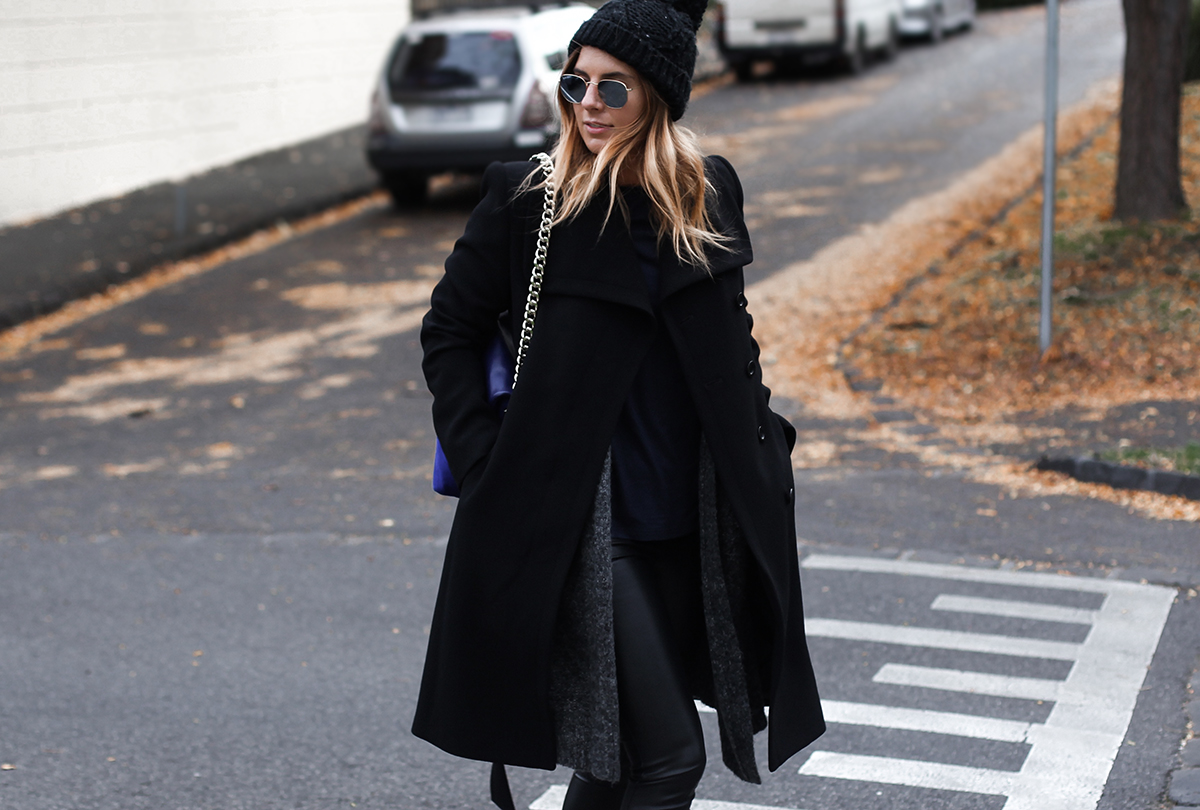 Australian fashion blogger Lisa Hamilton styling an all black outfit from Karen Millen for Autumn with a long black coat