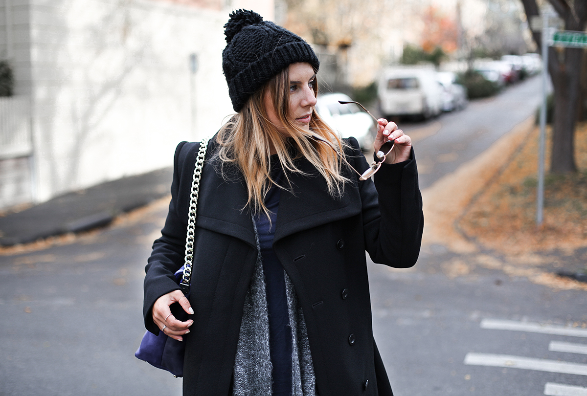 Australian fashion blogger Lisa Hamilton styling an all black outfit from Karen Millen for Autumn with a black pom-pom beanie