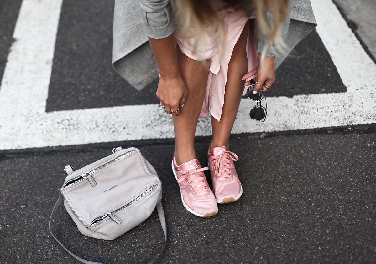 Style blogger Lisa Hamilton from See Want Shop styling Nike Air Max Zero blush pink sneakers in her outfit