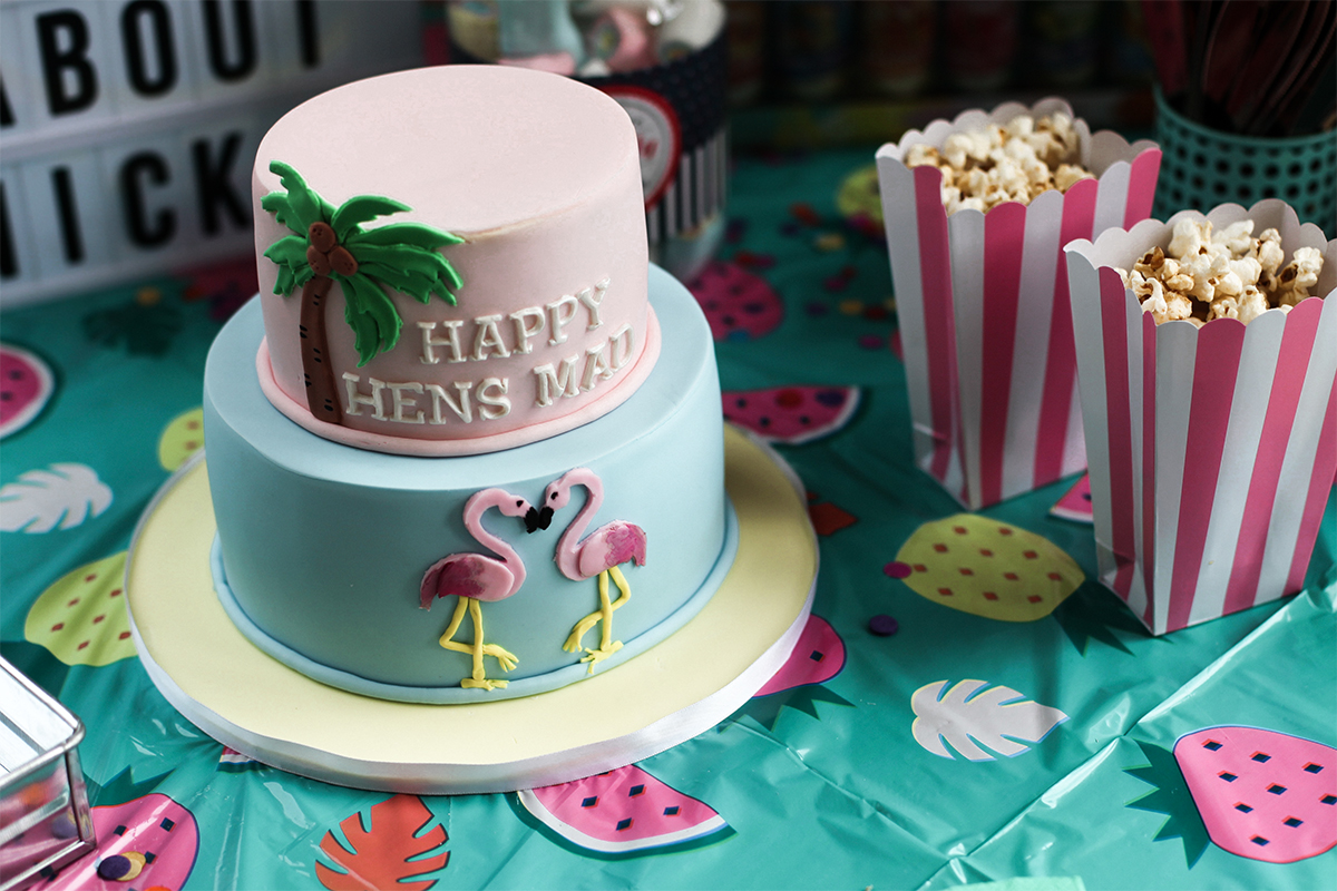 Lifestyle blogger Lisa Hamilton from See Want Shop styling a Palm Springs Bachelorette Party with a flamingo cake