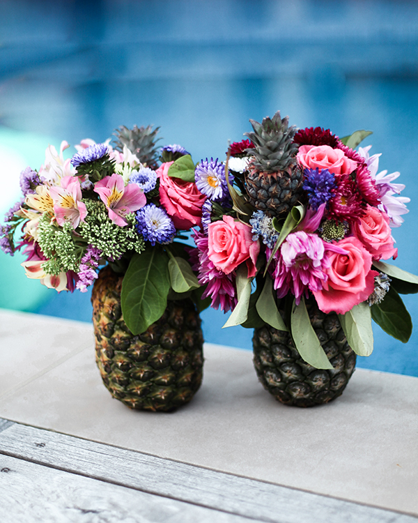 Palm Springs party, pineapple vases, flowers