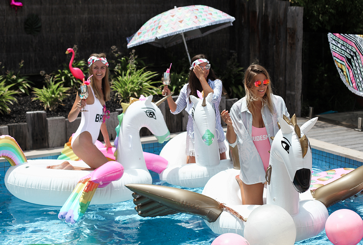 Lifestyle blogger Lisa Hamilton from See Want Shop styling a Palm Springs Bachelorette Party with pool inflatables