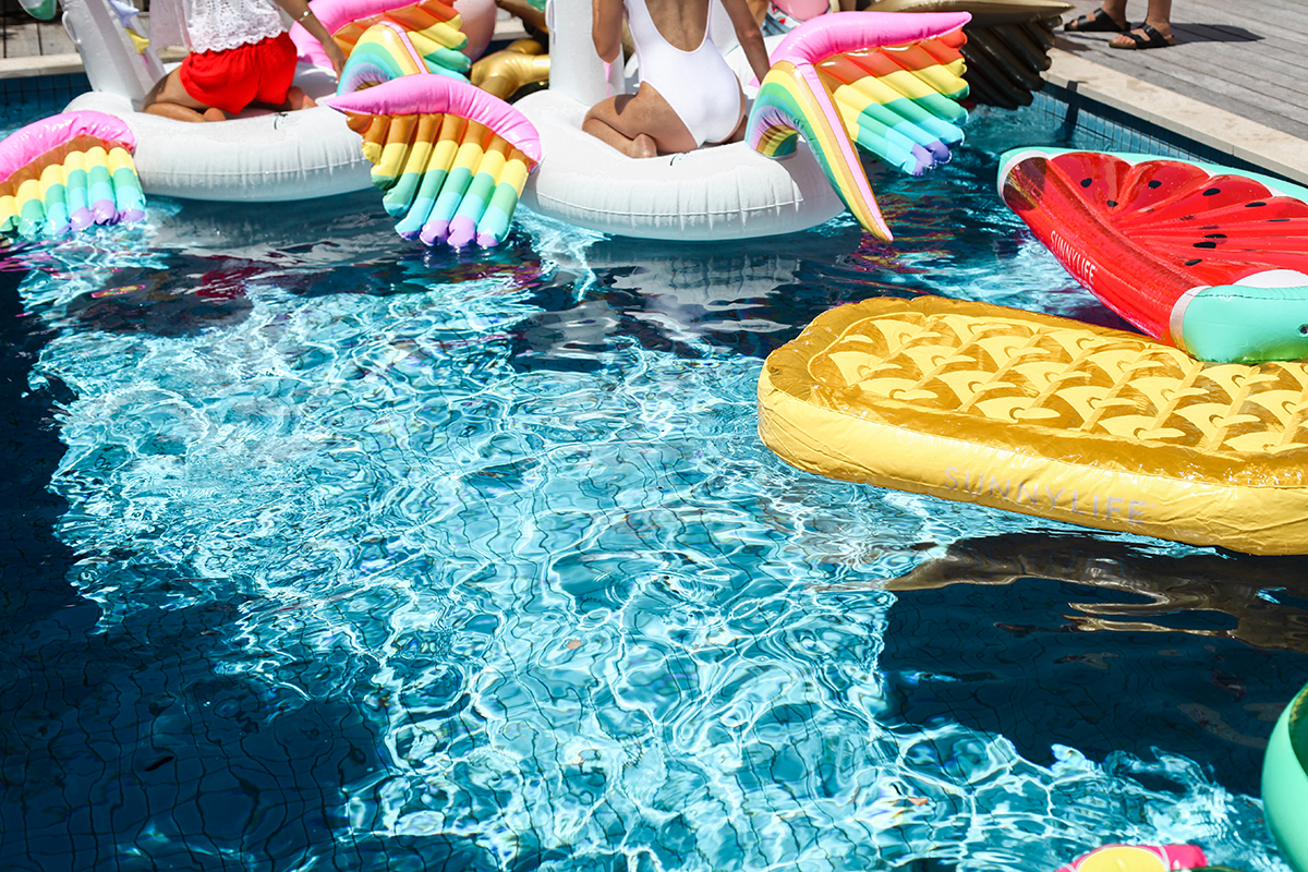 Lifestyle blogger Lisa Hamilton from See Want Shop styling a Palm Springs Bachelorette Pool Party