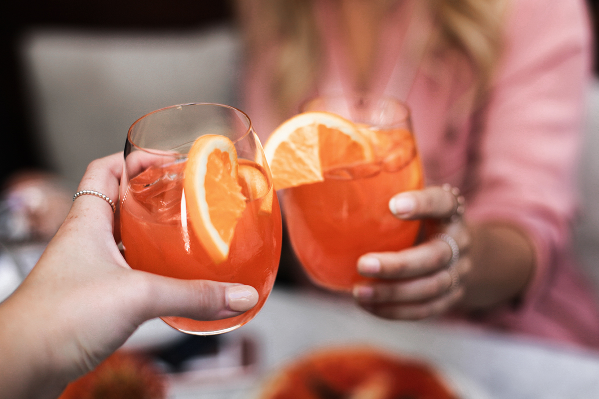 Cheers with Aperol Spritz