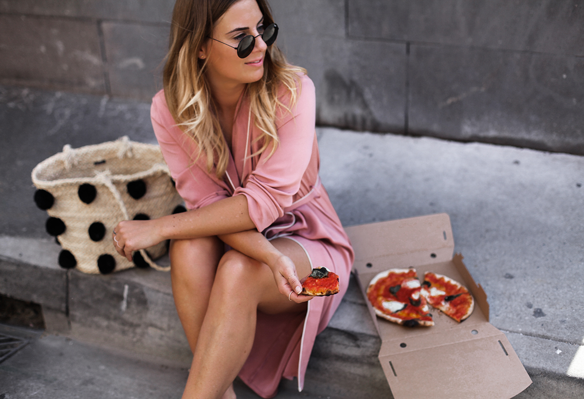Blogger Lisa Hamilton eating takeaway pizza