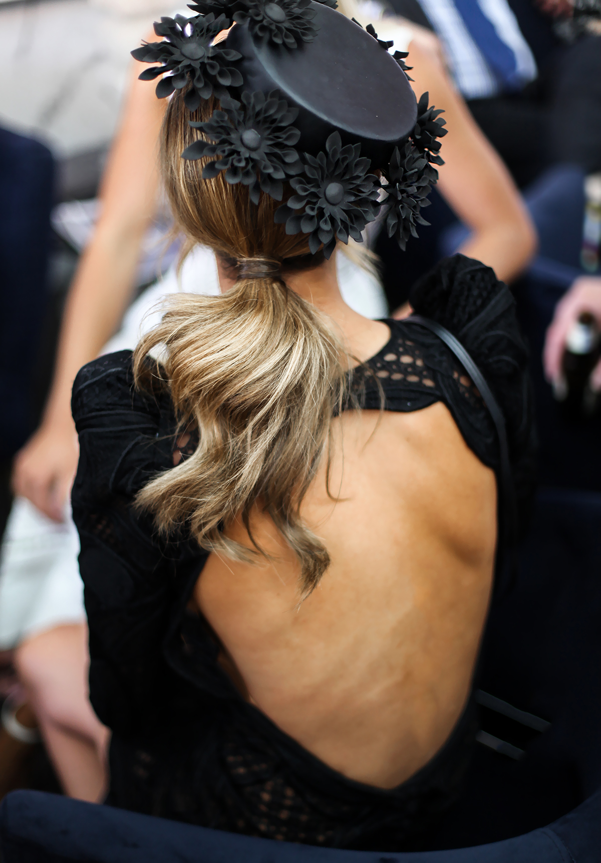 Britt Davis in backless dress at Derby Day