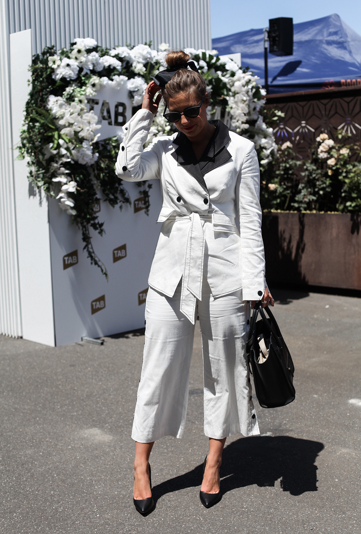 Blogger Lisa Hamilton in black and white suit at Derby Day