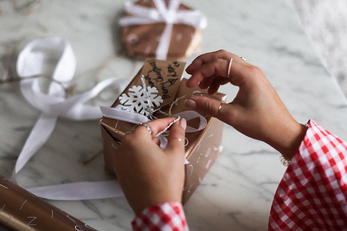 Wrapping Christmas presents in rose gold paper