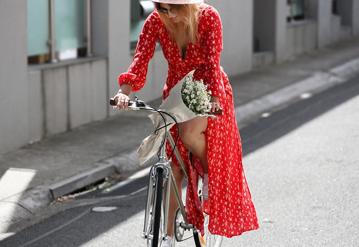 riding vintage bike in red dress