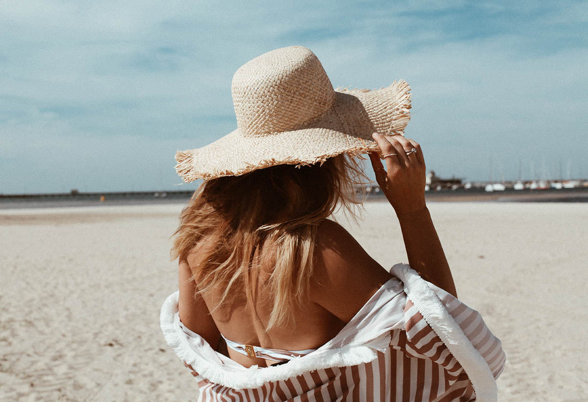 straw hat from Etsy at the beach