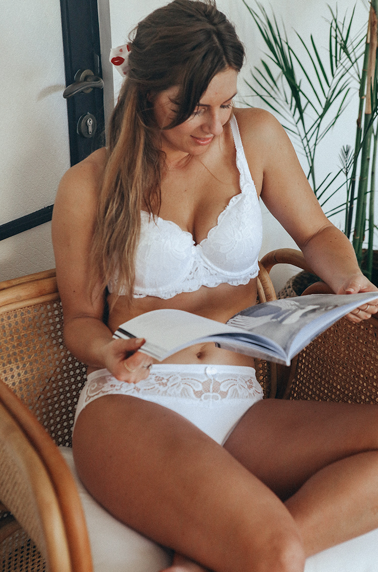 wearing white lace lingerie set